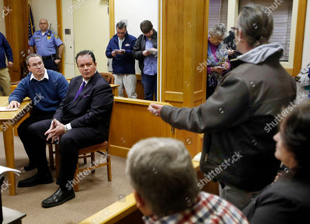 Dean Smart, brother of Gregory Smart, speaks to Patrick Randall, left, with his attorney Mark Stevens during Randall's parole hearing, in Concord, N.H. Randall was granted parole for his role in the killing of Gregory Smart in 1990