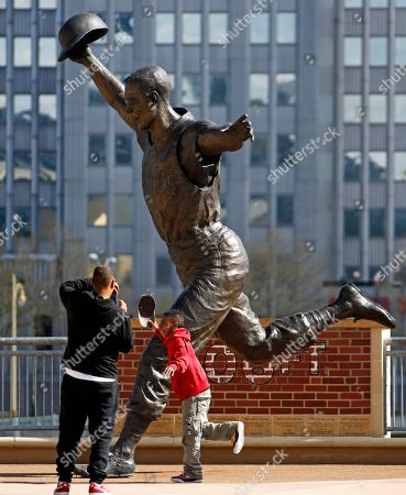 Alexander Ings, Daniel Ings By his dad Daniel Ings in front of a statue of Pittsburgh Pirates' Bill Mazeroski outside PNC Park in Pittsburgh