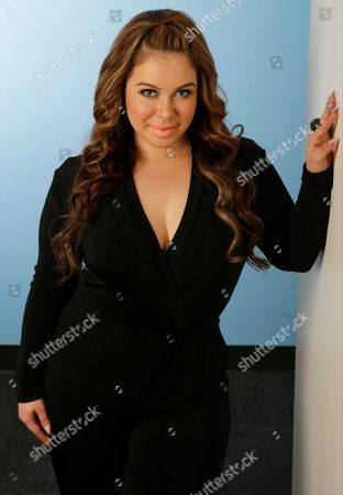 "Chiquis Rivera Singer Chiquis Rivera, the eldest daughter of the late singer Jenni Rivera, poses for a photo in Los Angeles. Rivera's new book, ""Perdon"" (Forgiveness) was released on April 7, 2015"