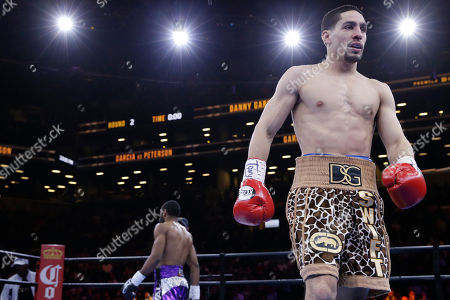 Danny Garcia, Lamont Peterson Danny Garcia, right, returns to his corner in the second round during a super lightweight boxing match against Lamont Peterson, in New York. Garcia won by a majority decision