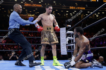 Danny Garcia, Lamont Peterson, Harvey Dock Referee Harvey Dock, left, stops the fight after Danny Garcia, center, sends Lamont Peterson to the canvas in the fourth round during a super lightweight boxing match, in New York. Garcia won by a majority decision