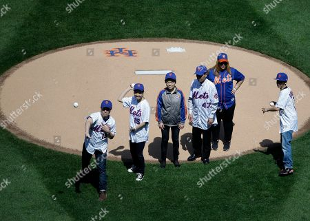 Pei Xia Chen, Justin Ramos, Jaden Ramos, Maritza Ramos, Wei Tang Liu, Xiu Yan Li The sons of police officer Rafael Ramos, Justin Ramos, left, and Jaden Ramos, right, and police officer Yenjian Liu's widow, Pei Xia Chen, second from left, throw out the ceremonial first pitch before the baseball game between the New York Mets and the Philadelphia Phillies at Citi Field, in New York. They were joined by Ramos' widow, Maritza Ramos, second from right, and Liu's parents, Wei Tang Liu, third from right, and Xiu Yan Li. The Mets honored the families of police officers Wenjian Liu and Rafael Ramos, who were killed in their patrol car on Dec. 20, 2014