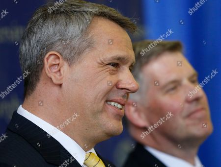 Scott Barnes, Patrick Gallagher Scott Barnes, left, answers questions during a news conference after he was introduced by University of Pittsburgh Chancellor Patrick Gallagher, right, as the new Athletic Director of the school's NCAA athletic programs, in Pittsburgh