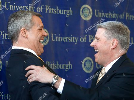 Scott Barnes, Patrick Gallagher University of Pittsburgh Chancellor Patrick Gallagher, right, shares a laugh with Scott Barnes after a news conference where Gallagher introduced Barnes as the university's new athletic director, in Pittsburgh