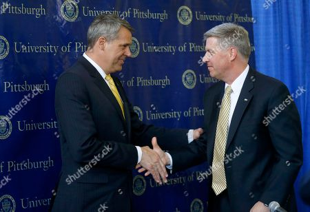 Scott Barnes, Patrick Gallagher University of Pittsburgh Chancellor Patrick Gallagher, right, shakes hands with Scott Barnes after a news conference where Gallagher introduced Barnes as the new Athletic Director, in Pittsburgh
