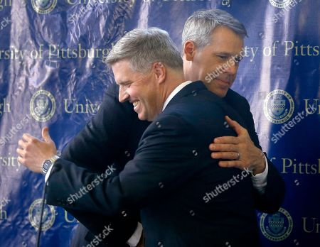 Scott Barnes, Patrick Gallagher University of Pittsburgh Chancellor Patrick Gallagher, left, embraces Scott Barnes at the beginning of a news conference where Gallagher introduced Barnes as the university's new athletic director, in Pittsburgh