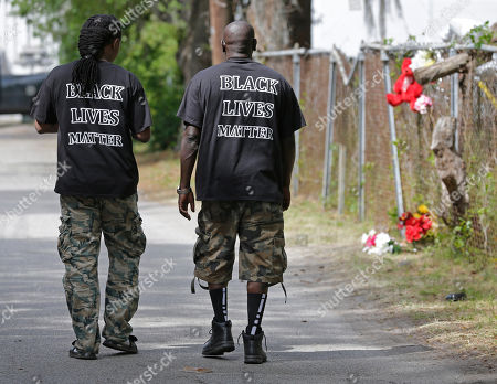 Stock Photo of Lenny Williams, James Johnson Lenny Williams, left, and James Johnson, right, walk by the scene where Walter Scott was killed by a North Charleston police officer Saturday after a traffic stop in North Charleston, S.C., . The officer, Michael Thomas Slager, has been fired and charged with murder