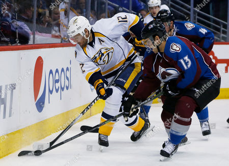 Mike Fisher, Freddie Hamilton Nashville Predators center Mike Fisher, left, loses control of the puck to Colorado Avalanche center Freddie Hamilton (13) during the second period of an NHL hockey game, in Denver