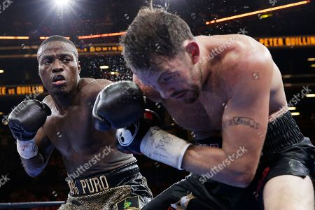 Peter Quillin, Andy Lee Peter Quillin, left, punches Andy Lee in the sixth round during a middleweight title boxing match, in New York. The match ended in a draw
