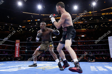 Peter Quillin, Andy Lee Peter Quillin, left, exchanges punches with Andy Lee in the fourth round during a middleweight title boxing match, in New York. The match ended in a draw
