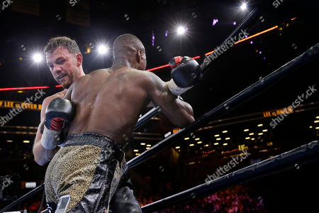 Peter Quillin, Andy Lee Andy Lee, left, and Peter Quillin exchange punches in the fifth round during a middleweight title boxing match, in New York. The match ended in a draw
