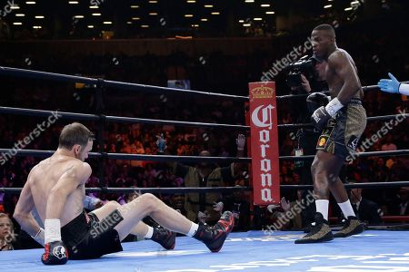Peter Quillin, Andy Lee Peter Quillin sends Andy Lee to the canvas during the first round of a middleweight title boxing match, in New York