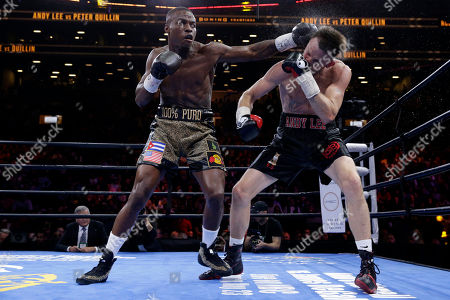 Peter Quillin, Andy Lee Peter Quillin, left, punches Andy Lee in the fifth round during a middleweight title boxing match, in New York. The match ended in a draw