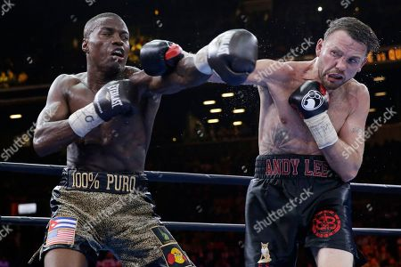 Andy Lee, Peter Quillin Peter Quillin, left,and Andy Lee exchanges punches in the 12th round during a middleweight boxing match, in New York. The match ended in a draw