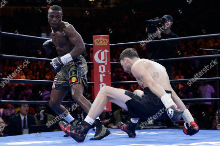 Peter Quillin, Andy Lee Peter Quillin, left, sends Andy Lee to the canvas during the third round of a middleweight title boxing match, in New York