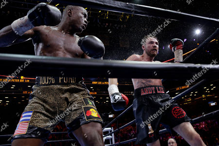 Peter Quillin, Andy Lee Peter Quillin, left, and Andy Lee exchange punches in the 10th round during a middleweight title boxing match, in New York. The match ended in a draw