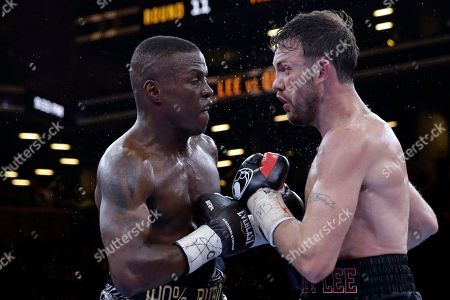 Peter Quillin, Andy Lee Peter Quillin, left, and Andy Lee exchange punches in the 11th round during a middleweight title boxing match, in New York. The match ended in a draw