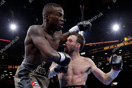 Peter Quillin, Andy Lee Peter Quillin, left, punches Andy Lee in the second round during a middleweight title boxing match, in New York. The match ended in a draw