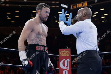 Steve Willis, Andy Lee Referee Steve Willis calls the count on Andy Lee in the first round during a middleweight title boxing match against Peter Quillin, in New York. The match ended in a draw