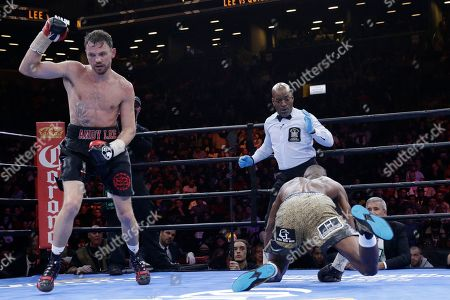 Andy Lee, Peter Quillin Andy Lee, left, sends Peter Quillin to the canvas in the seventh round during a middleweight title boxing match, in New York. The match ended in a draw