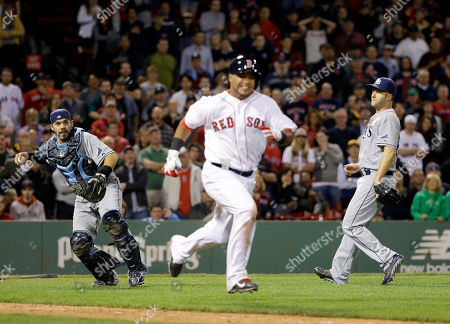Rene Rivera, Luis Jimenez, Brad Boxberger Tampa Bay Rays catcher Rene Rivera prepares to throw out Boston Red Sox's Luis Jimenez at first as Rays relief pitcher Brad Boxberger watches, right, to end the baseball game in the ninth inning at Fenway Park in Boston, . The Rays won 5-3
