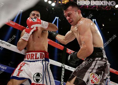 Sadam Ali, Francisco Santana Sadam Ali, left, follows through on a punch to Francisco Santana during the third round of a boxing bout, at Madison Square Garden in New York