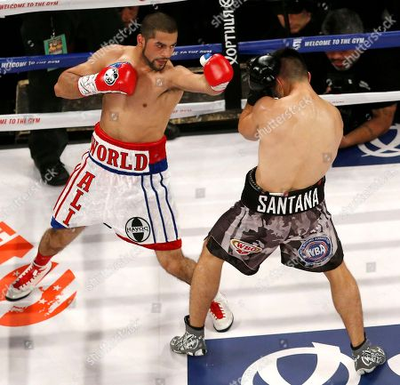 Sadam Ali, Francisco Santana Sadam Ali, left, throws a punch at Francisco Santana during the first round of a boxing bout, in New York. Ali won by decision