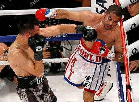 Sadam Ali, Francisco Santana Sadam Ali, right, is hit by Francisco Santana during the eighth round of a boxing bout, in New York. Ali won by decision