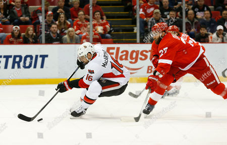 Clarke MacArthur, Kyle Quincey Ottawa Senators left wing Clarke MacArthur (16) skates around Detroit Red Wings defenseman Kyle Quincey (27) in the first period of an NHL hockey game in Detroit