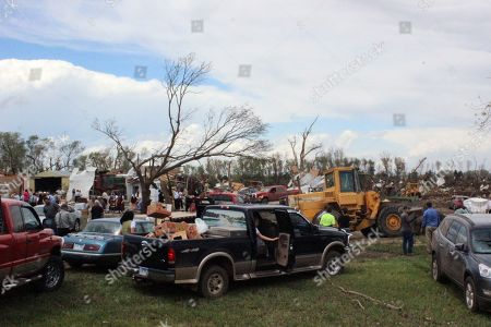Dozens of people gather to help with cleanup efforts at a farm that was severely damaged by a tornado, in Delmont, S.D. South Dakota was the center of weather extremes Sunday, with a tornado hitting the small town on the eastern side of the state and more than a foot of snow blanketing the Black Hills to the west