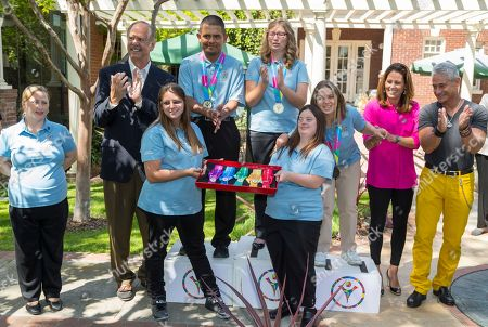 Stock Image of Debi Anderson, John Naber, Krystal Sylvia, Marco Martinez, Kimberly Guillen, Caley Versfelt, Lucy Meyer, Julie Foudy, Greg Louganis Olympic gold medalists: John Naber, second from left, Julie Foudy, second from right, and Greg Louganis, far right, unveil the 2015 Special Olympics World Games medals and distinction ribbons, to mark the 100 days away to the 2015 Special Olympics World Games at the LA84 Foundation in Los Angeles . Front row from left, Special Olympics athletes: Debi Anderson, Krystal Sylvia and Caley Versfelt. Back row, Medalists: Marco Martinez, silver, Kimberly Guillen, gold and Lucy Meyer, bronze