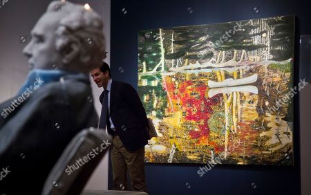 """Christie's The oil painting """"Swamped"""" by Peter Doig, right, and an untitled wax sculpture by Urs Fischer, left, are displayed during Christie's Spring 2015 Evening Sale press preview, in New York. New York City's spring art auctions get underway Tuesday with work from prominent artists fueling a robust market for impressionist, modern and contemporary art"""