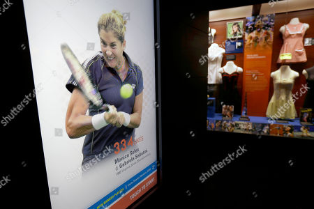 Monica Seles An image of tennis player Monica Seles, left, is displayed on an interactive video screen near an exhibit on tennis fashion, right, at the International Tennis Hall of Fame, in Newport, R.I. The International Tennis Hall of Fame is to reopen its museum May 20 following a complete renovation