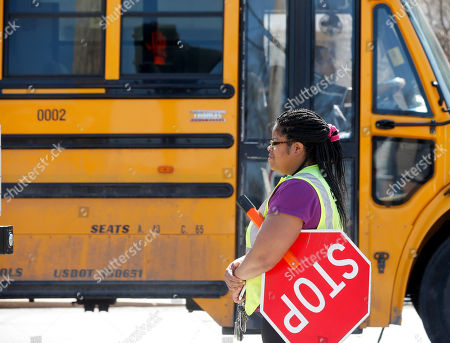 Jackie Moore Crossing guard Jackie Moore waits for a school bus to pass at the Albany School of Humanities, in Albany, N.Y. With standardized English tests set to begin Tuesday in New York schools, some parents are again planning to have their children sit out the exams