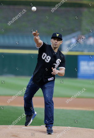 Billy Dec Billy Dec of Chicago White Sox Asian Heritage Night, throws out a ceremonial first pitch before a baseball game between the Chicago White Sox and the Detroit Tigers in Chicago on