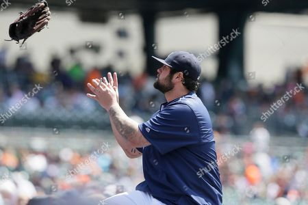 Joba Chamberlain Detroit Tigers relief pitcher Joba Chamberlain catches a fan's glove to autograph before the first inning of a baseball game against the Minnesota Twins, in Detroit