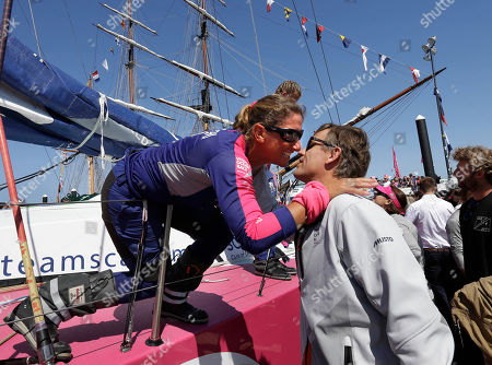 Dee Caffari, Knut Frostad Dee Caffari, team SCA crew member, of Southampton, England, left, embraces Volvo Ocean Race CEO Knut Frostad, of Norway, right, as the SCA crew disembark on arrival in Newport Harbor, in Newport, R.I. The SCA boat is the only one in the race with an all-female crew. Newport is the only North American stopover of the race, a nine-month, 10-port circumnavigation