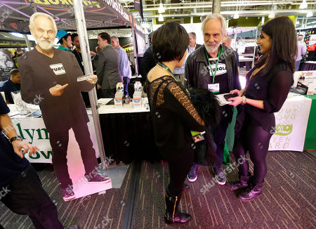 """Tommy Chong Comedian and marijuana icon Tommy Chong, second from right, talks to visitors as he stands near a life-sized cardboard cut-out of himself, while promoting his line of marijuana products, including his """"Chongwater"""" hemp drink, a custom joint roller, and his """"Smoke Swipe"""" wipes that can remove the odor of pot smoke from clothing, during CannaCon, a marijuana business trade show in Seattle. On, singer Willie Nelson joined the list of Chong and other celebrities promoting pot-related products, saying he plans to roll out his own brand of marijuana called ''Willie's Reserve"""