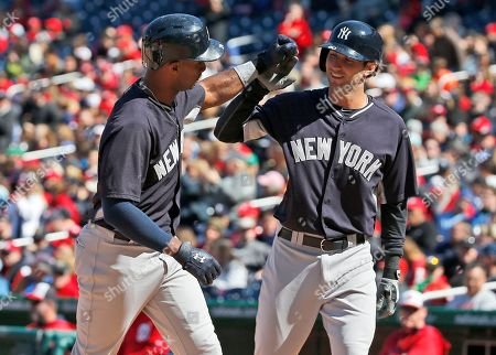 Chris Young, Nick Noonan New York Yankees' Chris Young, left, celebrates with pinch runner Nick Noonan after Young's two-run home run during the eighth inning of an exhibition baseball game against the Washington Nationals at Nationals Park, in Washington. The Yankees won 4-3