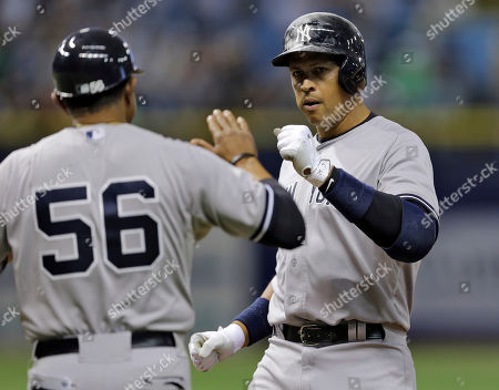 Alex Rodriguez, Tony Pena New York Yankees' Alex Rodriguez, right, high fives first base coach Tony Pena after his RBI single off Tampa Bay Rays relief pitcher Kevin Jepsen scored Brett Gardner during the eighth inning of a baseball game, in St. Petersburg, Fla