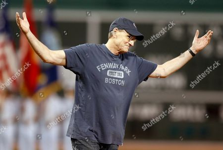 Jmaes Taylor James Taylor reacts after throwing out the ceremonial first pitch before a baseball game between the Boston Red Sox and the New York Yankees in Boston