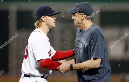 Brock Holt, James Taylor James Taylor shakes hands with Boston Red Sox's Brock Holt (26) after throwing out the ceremonial first pitch before a baseball game between the Red Sox and the New York Yankees in Boston