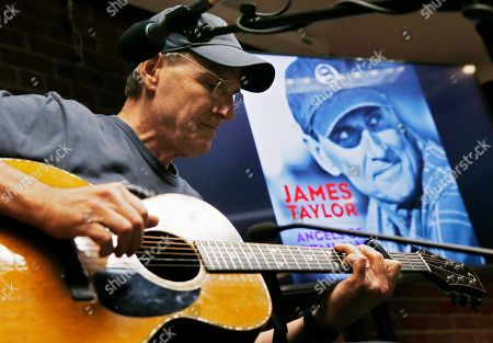 """James Taylor James Taylor plays guitar during a news conference to promote his new song """"Angels of Fenway"""" about the Boston Red Sox before a baseball game between the Red Sox and the New York Yankees in Boston"""