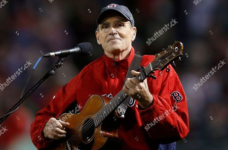 """James Taylor James Taylor plays """"America the Beautiful"""" during the seventh inning of a baseball game between the Boston Red Sox and the New York Yankees in Boston"""