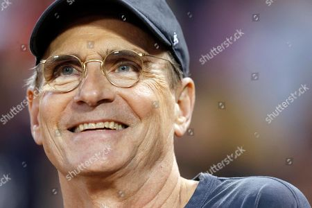 James Taylor James Taylor waits to throw out the ceremonial first pitch before a baseball game between the Boston Red Sox and the New York Yankees in Boston