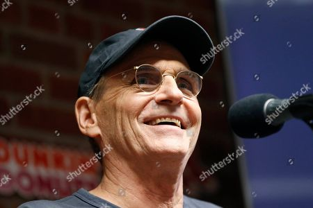 """James Taylor James Taylor speaks during a news conference to promote his new song """"Angels of Fenway"""" about the Boston Red Sox before a baseball game between the Red Sox and the New York Yankees in Boston"""
