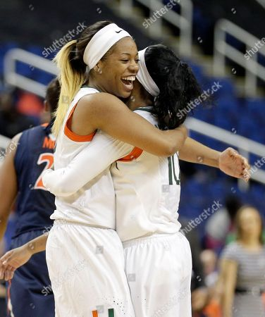 Erykah Davenport, Michelle Woods Miami's Erykah Davenport, left, hugs Michelle Woods, right, during the first half of an Atlantic Coast Conference women's tournament basketball game against Virginia in Greensboro, N.C., . Miami won 62-52