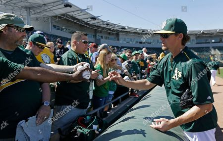 Tyler Clippard Oakland Athletics' Tyler Clippard, right, prepares to autograph baseballs prior to a spring training baseball game against the Chicago White Sox in Mesa, Ariz. The Oakland Athletics topped even their most trade-happy of days by making nine swaps involving 27 players in a wild offseason for Billy Beane and his front-office bunch