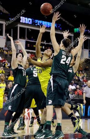 Stock Image of Danielle Williams, Anna Morrissey, Lexi Gussert Michigan guard Danielle Williams (20) shoots against Michigan State guard Anna Morrissey (14) and guard/forward Lexi Gussert (24) during the second half of an NCAA college basketball game in the Big Ten women's tournament in Hoffman Estates, Ill., on . Michigan State won 69-49