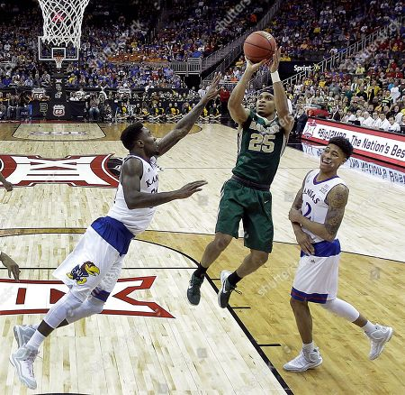 Al Freeman Baylor's Al Freeman (25) gets past Kansas' Jamari Traylor, left, and Kelly Oubre Jr. (12) to put up a shot during the first half of an NCAA college basketball game in the semifinals of the Big 12 Conference tournament, in Kansas City, Mo